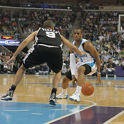 29 March 2009: New Orleans Hornets guard Chris Paul (3) drives past San Antonio Spurs guard Tony Parker (9) during a NBA game between Southwestern Conference rivals the New Orleans Hornets and the San Antonio Spurs at the New Orleans Arena in New Orleans, Louisiana.
