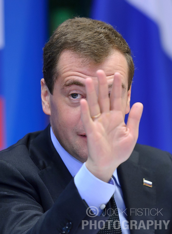 "Dmitry Medvedev, Russia's president, gestures during the EU-Russia summit at the European Union council headquarters in Brussels, Belgium, on Tuesday, Dec. 7, 2010. Russia will move a step closer to membership in the World Trade Organisation today when it signs an agreement with the European Union settling ""key questions"" that have hampered its accession bid for years. (Photo © Jock Fistick).."