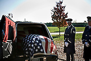 The Air Force Honor Guard wait to carry Bill Frizzell to his final resting place in the Arlington National Cemetery on November 8th, 2010.