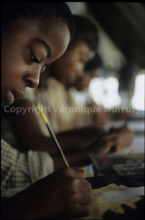 CHILDREN AT THE PAINTING SCHOOL OF POTO POTO , BRAZZAVILLE, CONGO