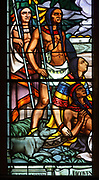 Indians, detail, stained glass window designed by Jean-Baptiste Lagace and made by Francois Chigot of Limoges, France, in the nave of the Basilique Notre-Dame de Montreal, built in 1823 in Gothic Revival style by James O'Donnell, in Montreal, Quebec, Canada. The windows were commissioned in 1929 by the priest Olivier Maurault to celebrate the centenary of the basilica. The depict the history of Montreal. The basilica is listed as a National Historic Site of Canada. Picture by Manuel Cohen