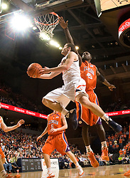 Virginia guard Sammy Zeglinski (13) leaps past Clemson forward Jerai Grant (45) for a reverse layup.  The Virginia Cavaliers defeated the #12 ranked Clemson Tigers in overtime 85-81 at the John Paul Jones Arena on the Grounds of the University of Virginia in Charlottesville, VA on February 15, 2009.