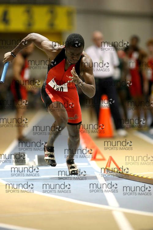 Windsor, Ontario ---14/03/09--- Sam Effah of  the University of Calgary competes in the 4x200m Relay Final at the CIS track and field championships in Windsor, Ontario, March 14, 2009..Sean Burges Mundo Sport Images