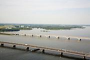 Nederland, Zuid-Holland, Hollandsch Diep, 04-07-2006;  Moerdijkbruggen: in de voorgrond de brug voor het autoverkeer (A16), daarachter de nieuwe brug voor de HSontworpen door Benthem Crouwel, verscholen achter de HSL-brug de oude spoorbrug; in de achtergrond de Dordtsche Biesbosch..zie ook andere foto's van deze lokatie (lucht en panorama); deevan de serie Panorama Nederland.View on the Moerdijk bridges, in the fornt the motor road bridge (A16), behind it, the new raibridge for the HST, designed by Benthem Crouwel..luchtfoto (toeslag); aerial photo (additional fee required); .foto Siebe Swart / photo Siebe Swart