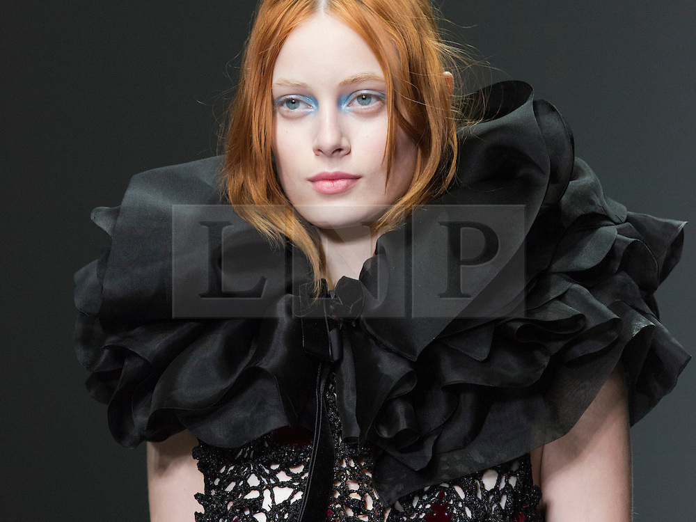 © Licensed to London News Pictures. 15 February 2014, London, England, UK. A model walks the runway at the John Rocha show during London Fashion Week AW14 at Somerset House. Photo credit: Bettina Strenske/LNP