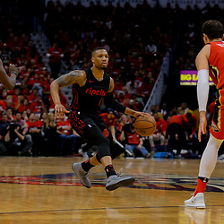 Apr 19, 2018; New Orleans, LA, USA; Portland Trail Blazers guard Damian Lillard (0) against the New Orleans Pelicans guard Jrue Holiday (11) and forward Nikola Mirotic (3) during the second half in game three of the first round of the 2018 NBA Playoffs at the Smoothie King Center. The Pelicans defeated the Trail Blazers 119-102.  Mandatory Credit: Derick E. Hingle-USA TODAY Sports