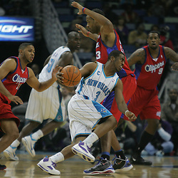 Jan 13, 2010; New Orleans, LA, USA;New Orleans Hornets guard Chris Paul (3) drives past Los Angeles Clippers forward Marcus Camby (23) during the first quarter at the New Orleans Arena. Mandatory Credit: Derick E. Hingle-US PRESSWIRE