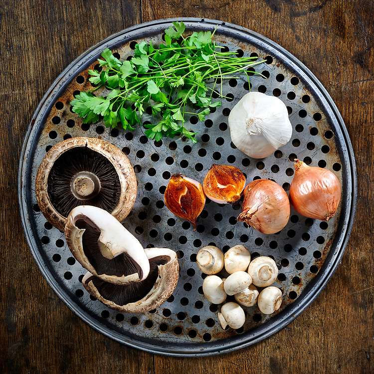 Pizza ingredients on a baking tray.