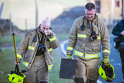 © Licensed to London News Pictures. 27/02/2019. Marsden UK. Fire crews at the scene of a large fire on Saddleworth moor this morning near the town of Marsden in Yorkshire. Photo credit: Andrew McCaren/LNP
