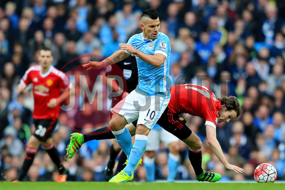 Sergio Aguero of Manchester City battles with Daley Blind of Manchester United  - Mandatory byline: Matt McNulty/JMP - 20/03/2016 - FOOTBALL - Etihad Stadium - Manchester, England - Manchester City v Manchester United - Barclays Premier League