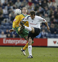 Photo: Aidan Ellis.<br /> Preston North End v Norwich City. Coca Cola Championship. 08/04/2006.<br /> Preston's Marcus Stewart clears from Norwich's Carl Robinson