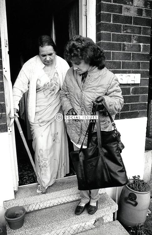 Carer & elderly woman, Nottingham UK 1989