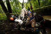 Bill Dragoo from Oklahoma (gray helmet) pushes bike while Kevin ? from Paso Robles California pulls and Briene Thompson from San Diego (blue gear) guides R1200GS out of water-filled creek.  Rain from Hurricane ? had drenched the Spartanburg area two days before the competion.