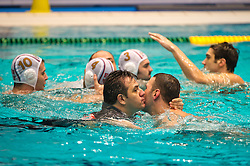 29-01-2012 WATERPOLO: EC SERBIA - MONTENEGRO: EINDHOVEN<br /> European Championships gold medal match Serbia - Montenegro / Head Coach Dejan Udovicic SRB in the swimming pool with his players after winning the gold medal match<br /> (c)2012-FotoHoogendoorn.nl / Peter Schalk