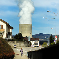 School child going home for lunch in a town close to G&ouml;sgen Nuclear Power Plant (Kernkraftwerk G&ouml;sgen), with smoke rising from its cooling tower. <br />