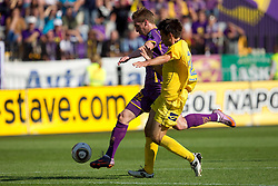Robert Beric of Maribor vs Luka Elsner of Domzale during football match between NK Maribor and NK Domzale of 36th - Last Round of 1st Slovenian football league PrvaLiga, on May 29, 2011 in Stadium Ljudski vrt, Maribor, Slovenia. (Photo By Vid Ponikvar / Sportida.com)