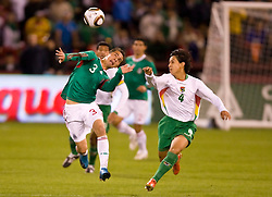 February 24, 2010; San Francisco, CA, USA;  Mexico defender Paul Aguilar (3) wins a header from Bolivia defender Marvin Bejarano (4)during the first half Candlestick Park.  Mexico defeated Bolivia 5-0.