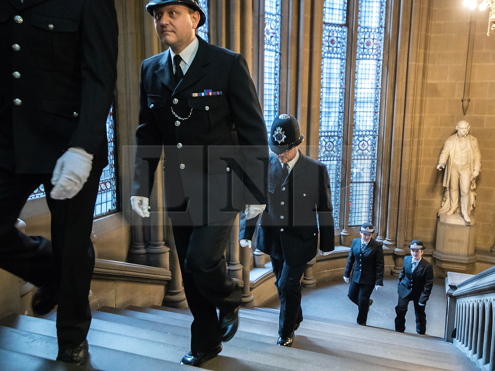 © Licensed to London News Pictures. 05/01/2018. Manchester, UK. A police honour guard lines the stairway to the Great Hall . Police officers and railway workers who came to the aid of victims in the wake of the terrorist attack at an Arina Grande concert at the Manchester Arena in May 2017 are honoured at a commendation ceremony at the Great Hall at Manchester Town Hall. Amongst those honoured are officers from British Transport Police and Northern Rail staff . Photo credit: Joel Goodman/LNP