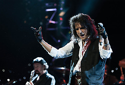 "© Licensed to London News Pictures. 16/09/2012. London, UK.  Alice Cooper performs at The Sunflower Jam at the Royal Albert Hall.  The Sunflower Jam is a British charity, founded by Jacky Paice, wife of Deep Purple drummer, Ian Paice. Other high-profile supporters are the actor Jeremy Irons, ex-Jamiroquai bassist Nick Fyffe and Charles, Prince of Wales. The aims of the charity are to fund complementary therapists and spiritual healers to work on cancer wards in the British National Health Service. After setting up a meeting between members of Deep Purple and a young boy dying of leukemia, Paice saw ""all the good work the healers were doing"" and decided ""lets find a way to raise money to get more healers in there. Photo credit : Richard Isaac/LNP"