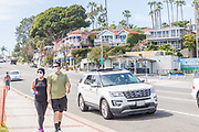 People Walking With Face Masks on Pacific Coast Highway During Corona Virus Pandemic