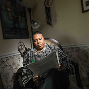 Former UD professor Arica Coleman reads correspondence at her home Wednesday. Feb. 27, 2019, in Newark, DE. <br /> <br /> Former UD professor was denied tenure. She believes it was discriminatory