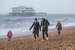 © Licensed to London News Pictures. 30/12/2017. Brighton, UK. Members of the public brave the windy weather to spent time on the beach in Brighton and Hove. Photo credit: Hugo Michiels/LNP