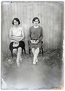 fading glass plate of two woman with magazine