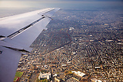 Aerial view from window of a jet airplane flying into New York, USA