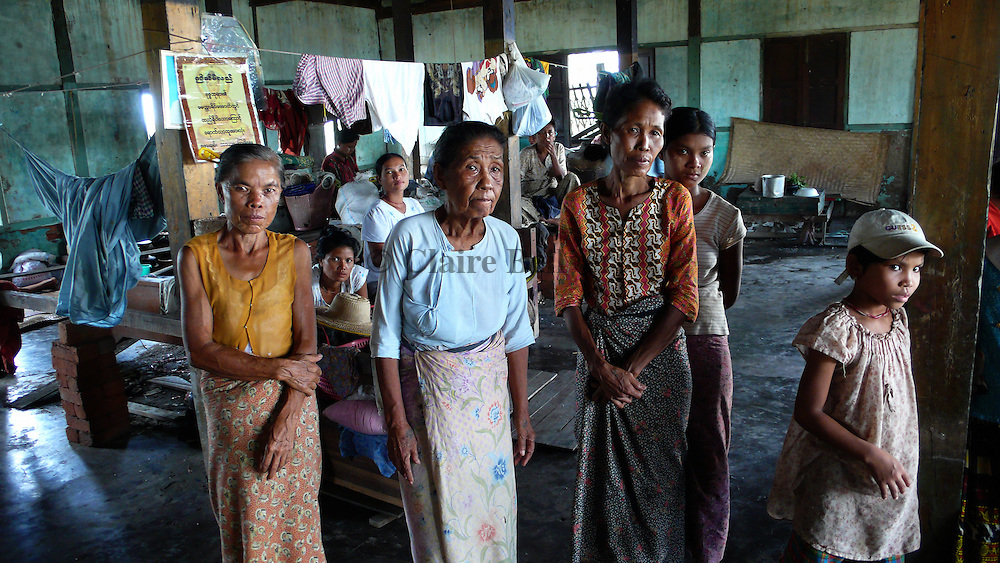 These women lost their homes in Cyclone Nargis and found shelter in the monastery near their village. Around two hundred pepole are staying there. and they have so far received no medical or food aid, except some rice from Burmese citizens from Rangoon.