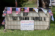 Accord, New York  - Signs and American flags were set up  along Route 209, where the public lined up to honor U.S. Army Sgt. Shawn M. Farrell II on May 7, 2014. Farrell died April 28 when forces attacked his unit with small arms fire in Afghanistan.