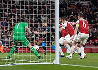 Football - 2018 / 2019 UEFA Europa League - Quarter Final, First Leg Arsenal vs. Napoli <br /> <br /> Elseid Hysaj (Napoli) races to loose ball as the Arsenal defence close in at The Emirates.<br /> <br /> COLORSPORT/DANIEL BEARHAM