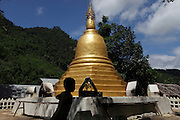 A gold painted Stupa, a buddhist monument, in the Mae La refugee camp.