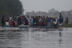 June 30, 2017 - Lahore, Punjab, Pakistan - Pakistani people taking boat ride in River Ravi during pleasant weather in the Provincial Capital Lahore after monsoon rain. (Credit Image: © Rana Sajid Hussain/Pacific Press via ZUMA Wire)