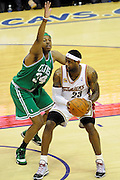May 1, 2010; Cleveland, OH, USA; Boston Celtics forward Paul Pierce (34) puts pressure on Cleveland Cavaliers forward LeBron James (23) during the first quarter of game one in the eastern conference semifinals in the 2010 NBA playoffs at Quicken Loans Arena. Mandatory Credit: Dave Miller-US PRESSWIRE