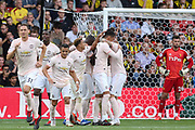GOAL - Manchester United Defender Chris Smalling is congratulated by Manchester United Midfielder Jesse Lingard, Manchester United Defender Victor Lindelof and Manchester United Forward Romelu Lukaku during the Premier League match between Watford and Manchester United at Vicarage Road, Watford, England on 15 September 2018.