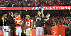 Jan 19, 2020; Kansas City, Missouri, USA; Former Kansas City Chiefs player Bobby Bell and CBS sportscaster Jim Nantz and Kansas City Chiefs quarterback Patrick Mahomes (15) and strong safety Tyrann Mathieu (32) and tight end Travis Kelce (87) and general manager Brett Veach (left to right) celebrate on stage after the AFC Championship Game against the Tennessee Titans at Arrowhead Stadium. Mandatory Credit: Denny Medley-USA TODAY Sports