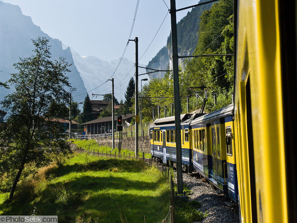 "Berner Oberland Bahn (BOB) enters Lauterbrunnen Valley  on narrow-gauge railway tracks in the Bernese Oberland region of Switzerland, the Alps, Europe. BOB serves Interlaken, Lauterbrunnen, and Grindelwald via a ""Y"" junction at Zweilütschinen. At Wilderswil, BOB extends 7 km on Schynige Platte Railway. The trains are assisted in steep sections by rack and pinion (cog wheel drive). UNESCO lists ""Swiss Alps Jungfrau-Aletsch"" as a World Heritage Area (2001, 2007)."