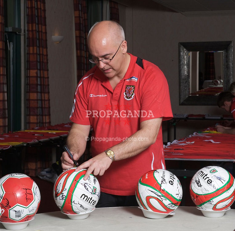 CARDIFF, WALES - Wednesday, March 25, 2009: Wales' press officer Ceri Stennett marks-up signed footballs at the Vale of Glamorgan ahead of the 2010 FIFA World Cup Qualifying Group 4 match against Finland. (Pic by David Rawcliffe/Propaganda)