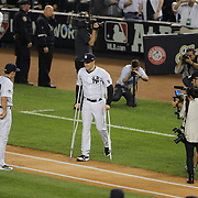 Mark Teixeira, New York Yankees, hobbles out to the team line up on crutches before the New York Yankees Vs Houston Astros, Wildcard game at Yankee Stadium, The Bronx, New York. 6th October 2015 Photo Tim Clayton for The Players Tribune