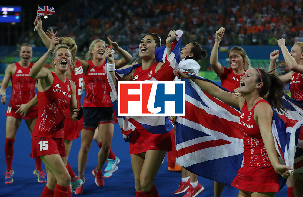RIO DE JANEIRO, BRAZIL - AUGUST 19:  Great Britain celebrates after winning a penalty shoot out during the Women's Hockey final between Great Britain and the Netherlands on day 14 at Olympic Hockey Centre on August 19, 2016 in Rio de Janeiro, Brazil. (Photo by Ian MacNicol/Getty Images)