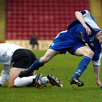 Clyde v St Johnstone..  07.12.02<br />Mark Baxter is brought down by David Hagan<br /><br />Pic by Graeme Hart<br />Copyright Perthshire Picture Agency<br />Tel: 01738 623350 / 07990 594431