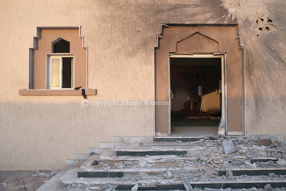 Libya: The damaged by explosion entrance of a mosque nearby by Zafran square in Sirte. Alessio Romenzi