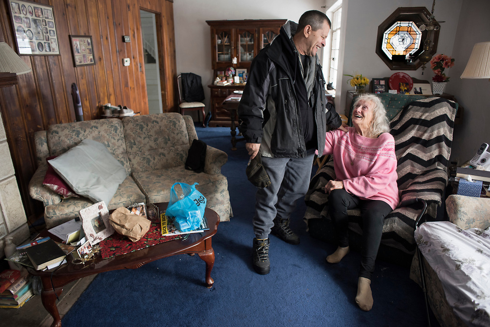 DeAnne Alberti visits with her Meals on Wheels driver Dale Weston at her home in McCandless Township. Weston drops off meals to DeAnne three times a week and always spends a few minutes to visit with Alberti. He has  SERVtracker mobile homecare app on his phone that allows him to alert an intervention specialist if there is a change in a consumers' condition. There are eight agencies providing Meal on the Wheels in Allegheny County.