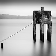 Nine Legged Structure, Columbia River, Astoria.  This concrete structure, once located at the heart of a thriving fish processing and packing industry, is all that remains of the wooden pier and pilings that once surrounded it.  Astoria, Oregon, USA.