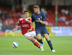 Southampton's Jordan Turnball battles for the ball with Swindon Town's Massimo Luongo - Photo mandatory by-line: Joe Meredith/JMP - Mobile: 07966 386802 21/07/2014 - SPORT - FOOTBALL - Swindon - County Ground - Swindon Town v Southampton