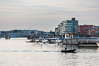 The Harbour Air floatplane base sits in front of the Johnson Street Bridge in the Inner Harbour of Victoria, BC on a summer evening.