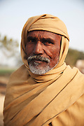 A portrait of Ghumano Babar, age unknown, who was enslaved for 2 years<br /> <br /> Following the release of the Global Slavery Index by the Walk Free Foundation Pakistan is ranked 3rd worse in the world behind India and China. The Asian Development Bank estimates some 1.8 million people are slaves in Pakistan yet other estimates reach up to 4 million people, most of which toil year after year in brick kilns or sugar cane plantations. Their stories are the same; they have no-where to turn so they borrow money from a land-owner for a medical emergency or marriage dowry. The landlords pay in return for work, their labour supposed to be taken off the amount borrowed. Yet after years of no salary incredibly their amount owed is often quadrupled, the excuse being the amount they cost to feed! Many are chained, abused, raped and even killed.<br /> <br /> For years they had no where to run, no one to help but now a small local NGO called the Green Development Rural Organisation (GDRO) works to free bonded-slaves by using the law against their captives. Yet, often freed slaves end up right back where they were or risk being hunted by the landowner and forced to return. So GRDO started building villages so slaves who escape or are freed have somewhere safe to go. It now has two, whose names translate from Urdu as 'Village of the Freed' and 'Village of the Courageous', and is working on a 3rd. The land is bought and allocated to freed slave families where they can built a house and start again. Without such help the vicious cycle would continue.
