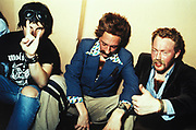 After Club, three incapacitated men wearing fake moustaches, chest hair and trendy attire, London, U.K, 1999.
