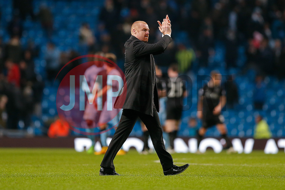 Burnley Manager Sean Dyche applauds the away supporters after the match ends in a 2-2 draw - Photo mandatory by-line: Rogan Thomson/JMP - 07966 386802 - 28/12/2014 - SPORT - FOOTBALL - Manchester, England - Etihad Stadium - Manchester City v Burnley - Barclays Premier League.