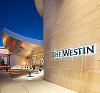 Exterior at dusk of the brand new Westin Nashville Hotel in Tennessee. The 28 story tower provided a challenge as the construction immediately around the project was on-going. The best solution was an architectural detail of the entry at dusk with an emphasis on the Logo.